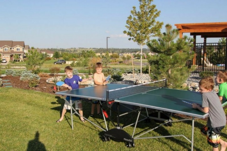 kids playing ping pong at lawn game social event at Inspiration community near Parker Co