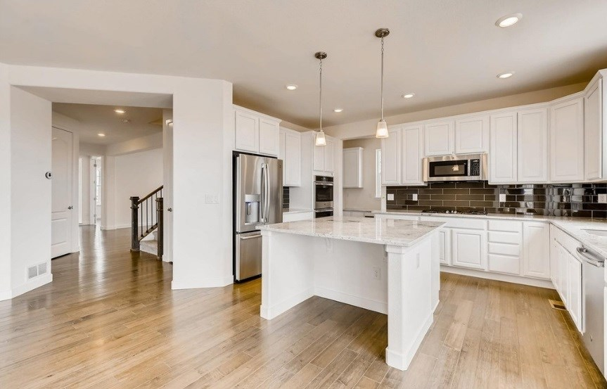 New home kitchen at 23159 E. Narrowleaf Dr. by Lennar